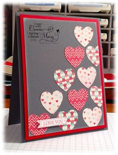 handmade Valentine ... like the gray layer with the reds ... punched hearts from patterned paper arraned symetrically to cover a diagonal half of the card ... Stampin' Up!
