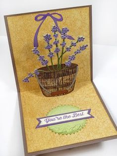 Annette Green created interactive card with Karen Burniston's Barrel basket with Pop Up die. Annette filled her barrel with Susan's Garden Club Garden Notes Lavender. Els van de Burgt Studio's Through the Lens patterned cardstock (Wood Series) is the perfect paper for the barrel die. Annette uses Soft Finish Cardstock in Olive Twist and Perfect Purple. Find everything you need to recreate Annette's card on our website: https://www.elizabethcraftdesigns.com/
