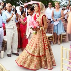 On her wedding day, in the definitive moment, Melanie looks graceful in a stunning Manish Malhotra lehenga from Exclusively.