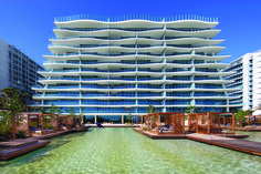 Fashion house-branded residential towers are springing up in Miami faster than anywhere else in the world. Armani Hotel, Burj Khalifa, Marina Bay Sands, Miami, New Homes, Towers, Real Estate, Exterior, House Styles