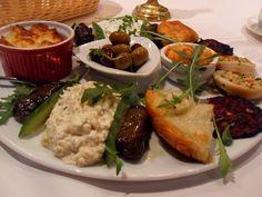 olives, saganaki cheese, dolmata, spanikapita, falafal, Hummus, Tzaziki, pita... all on one plate!?!? Orgasm in my mouth.