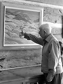 A.Y. Jackson Paintings | , Group of Seven member A.Y. Jackson looks over one of his paintings ... Never too old to self critique