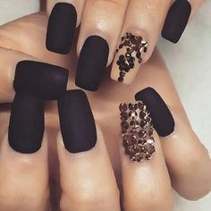 Matte black nails with gold jewels