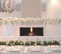 Modern all white reception dinner.