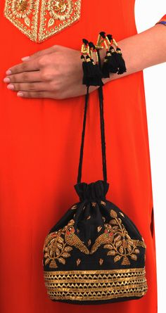 Parrot motif zardozi Potli by TISHA SAKSENA. Shop at https://www.perniaspopupshop.com/whats-new/tisha-saksena-10