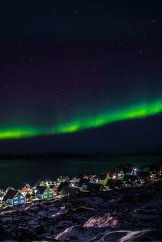 Northern lights over Nuuk, Greenland!  Why you need to visit Greenland on Avenly Lane Travel!