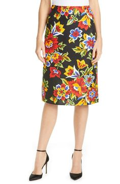 """SIZE INFO True to size. DETAILS & CARE This vivacious pencil skirt in a crisp cotton-silk blend flaunts colorful printed flowers inspired by house founder Carolina Herrera's Venezuelan heritage. 26 1/2"""" length (size 8) Hidden back-zip closure Unlined 77% cotton, 23% silk Dry clean Made in Italy  
