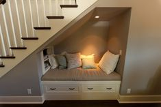 A small reading nook with a light, shelves, and drawer storage. Not only is it relaxing but it would make great use for the space under stairs, especially in a finished basement.