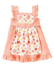 I love Janie and Jack's apron dresses for girls.