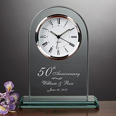This Engraved Anniversary Clock is gorgeous! You can have the personalized clock engraved with any Anniversary Number (it doesn't have to be their 50th) and any 2 names and wedding date! This is a great modern first anniversary gift or an even better anniversary gift idea for parents celebrating a milestone anniversary!