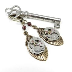 Handmade steampunk clockwork earrings featuring a pair of vintage mechanical watch movements with exposed gears and jeweled bearings mounted on beautiful antiqued brass metal Art Deco setting. This pa