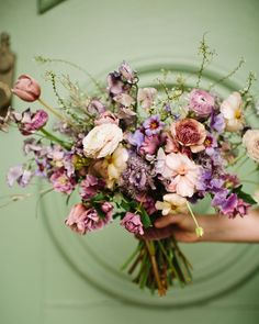Whimsical and organic purple bridal bouquet with delicate spring flowers like spirea, ranunculus, sweet peas, and tulips. Spring Flower Bouquet, Cascading Bridal Bouquets, Purple Wedding Bouquets, Lavender Bouquet, Wedding Flower Arrangements, Floral Wedding, Wedding Flowers, Spring Flowers, Spring