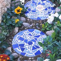 Tile-Topped Stepping Stones  Create a pretty garden path with the help of these handmade stepping stones decorated with pieces of ceramic tiles or plates.