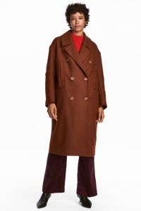 Red. Double-breasted coat in thick wool with a lightly brushed finish and notched lapels. Low dropped shoulders, handwarmer pockets at top, welt front