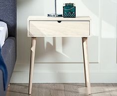 A simple light wooden bedside table is a great example of Scandinavian style Bedroom Sets, Home Bedroom, Bedroom Furniture, Home Furniture, Bedroom Decor, Bedrooms, Wooden Bedside Table, Bedside Cabinet, Scandinavian Style