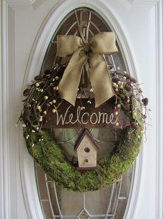 moss wreath, berry sprigs, bird house, welcome sign, burlap bow