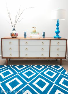 Ikea Hack: An inexpensive Erlsev rug and painted with a graphic pattern. Painters tape was used to create a design, together with regular wall paint diluted with a bit of water to paint on the pattern. | BirdHouse: Adventures in rug painting