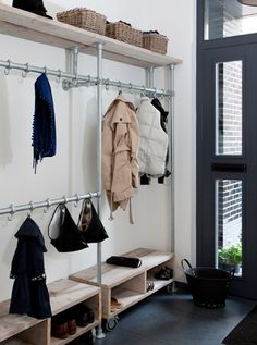 Small Space DIY: A Perfect Shoe Rack for a Narrow Entryway - Gardenista Narrow Entryway, Entryway Storage, Hallway Shelving, Entryway Closet, Garage Entry, Shoe Storage, Organized Entryway, Pipe Shelving, Industrial Shelving