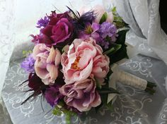 Purple Feather Bouquet and Boutonniere Set with Pink and Purple Wedding Roses, Orchids, Lilacs and Peonies. $175.00, via Etsy.