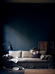 I love this Navy wall.   How To Go Minimal & Moody Without Seeming Too Dark & Sparse
