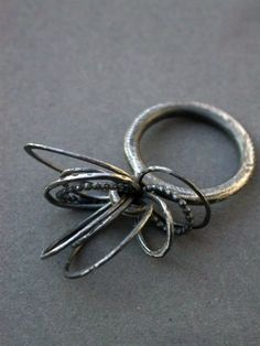 kinetic toy ring loops circles of metal mobile contemporary art jewelry jaime jo fisher oxidized sterling silver