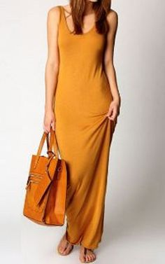 Awesome dress and color. Love the bag