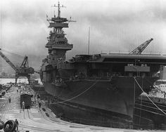 USS Yorktown undergoes emergency repairs at Pearl Harbor prior to the Battle of…
