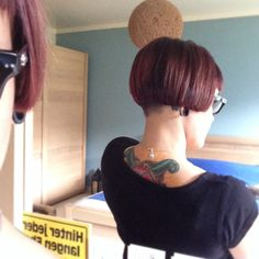 Short undercut bob with fringe and clippered nape.from go shorter