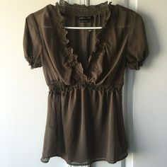 BCBG Sheer Ruffle Blouse Gorgeous on so many skin tones this blouse goes from day to night easily. Comfortable elastic bust and sleeves. Flows out from bust. Size XS. New without paper tag BCBGMaxAzria Tops Blouses