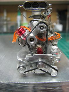 The Construction of my 426 Supercharger Hemi Alcohol Engine   Construction began with the block proceeded to the heads and blower manifold. A Kobelco superc...