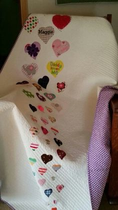 Modern Memory quilt by Quilts of the North. Hearts are cut from baby clothes.