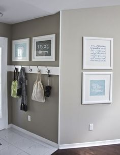 Love everything about this!  Painted 2X4 with hooks (simple and easy) and large framed prints.