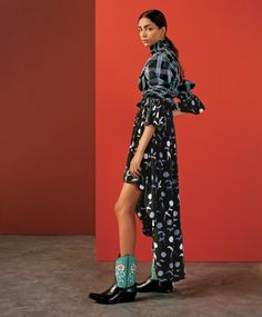 Kenzo top, $900, and dress (worn underneath), $2,075, kenzo.com. El Paso Booty boots, price on request. Photograph by Letty Schmiterlow. Styled by Elodie David-Touboul