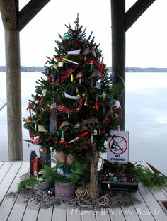 Christmas tree on boat dock decorated with fishing lures | homeiswheretheboatis.net