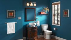 Nickel brushed accents and a pop of color on the wall can completely transform your bathroom.