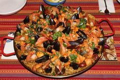 This is one of my all time favorite dishes. Ive been experimenting for a year now and I think Ive finally got it perfect. This recipe is for an 18 pallera cooked on an open flame (a weber grill works perfectly). For a smaller pan and stovetop cooking half the recipe. Note: Some purists say an authentic paella doesnt mix meat and seafood. I see it as a matter of taste, and most of the paella Ive had from various regions throughout Spain has been mixed. I leave the arguments to the old men in ... Seafood Paella, Seafood Dishes, Seafood Recipes, Mexican Food Recipes, Cooking Recipes, Ethnic Recipes, Spanish Recipes, Tapas Recipes, Spanish Cuisine
