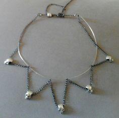 Collar de Calaveras, acero y cadenas, ajustable.