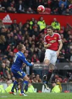 Michael Carrick of Manchester United in action with Marc Albrighton of Leicester City during the Barclays Premier League match between Manchester United and Leicester City at Old Trafford on May 1, 2016 in Manchester, England.