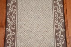 Caramel Scroll Border Carpet Runner - Purchase By the Linear Foot by Dean Flooring Company. $10.00. This Caramel Scroll Border runner is sold here by the linear foot. One unit of quantity equals one foot of length on your runner. These beautiful carpet runners match our Dean Flooring Company stair treads. This item will be finished (serged with color matching yarn) on all four sides regardless of the length. It is made from nylon with a non-skid back and scotchguard protection.