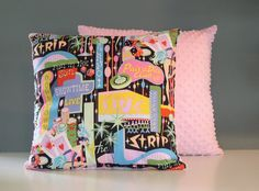 Retro Midcentury Las Vegas pillow sham with pink ultra soft minki fabric on one side and this Vegas Strip showgirl 60s style fabric on the other