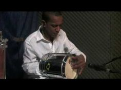 Good sample of Brazilian percussion -- need to translate some instrument names.