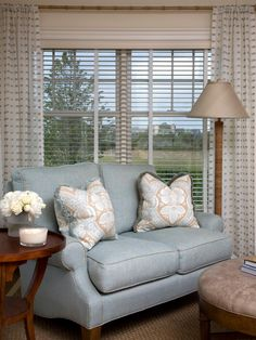 Combine panels with blinds for privacy and to add warmth to a room. For a natural and unique touch, designer Jennifer Duneier uses a bamboo rod to hang the panels.