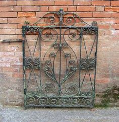 Old wrought-iron gate - would love one for the back yard.