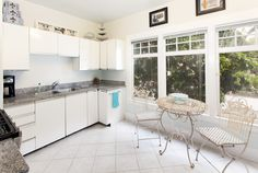 The kitchen of 1805 Pine Street #25 has abundant light from its large windows.