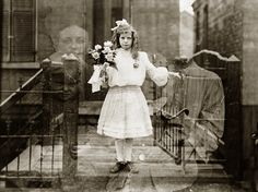 Young girl holds flowers, double exposure