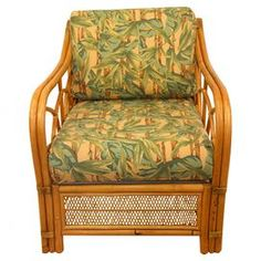 Vintage bamboo arm chair with tropical motif upholstery.   Product: ChairConstruction Material: BambooColor: Brown and greenFeatures:  Mid-century designUpholstered cushion Dimensions: 30.5 H x 27 W x 27 DNote: Due to the vintage nature of this product, some wear and tear is to be expected. Products may show signs of brand marks, scrapes or other blemishes.