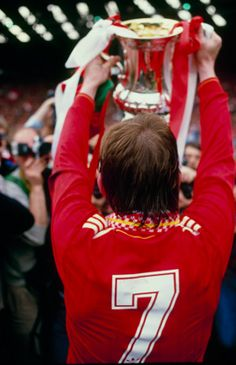 The King holds the FA Cup aloft after the Reds' 3-1 win over Everton at Wembley in 1986
