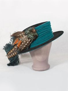 "French velvet hat with feather trim, c.1900-1910. The label in the crown reads ""George Allen, Inc./3 rue Bleue/Paris/1214 Chestnut Street/Philadelphia."""