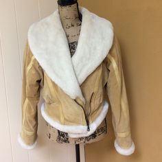 Wilsons suede & faux fur Moto jacket Fantastic jacket! By Wilkins leather. Beautiful neutral color suede trimmed in faux fur. Fits so perfect. Jeans and boots with this jacket equals a serious fashion statement. No flaws. EUC. Wilsons Leather Jackets & Coats