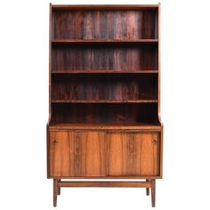 For Sale on 1stdibs - A Danish rosewood cabinet. Front with two doors and above with shelves. Made in Denmark, early 1960s.